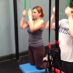 Amy doing resistance band pulldowns
